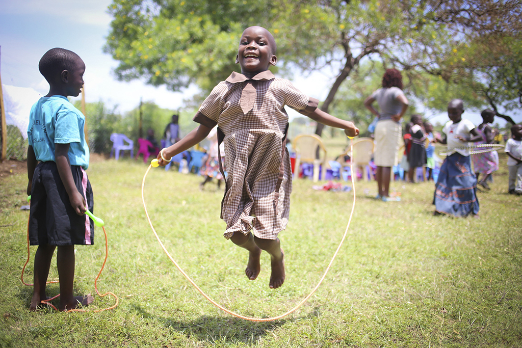 Young girl playing and skipping rope