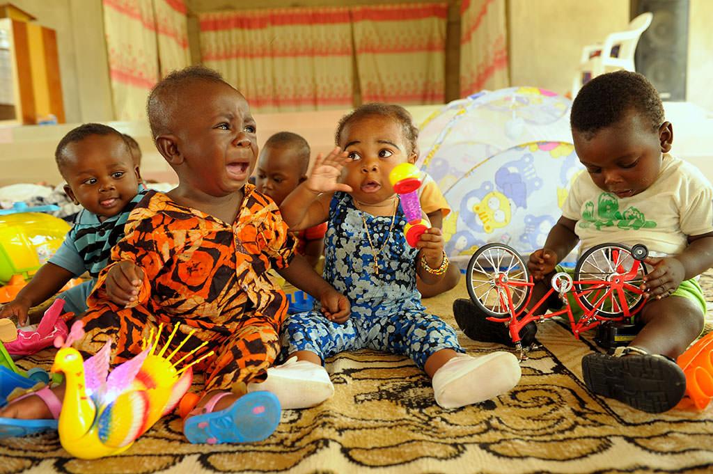 Babies stealing toys in Ghana