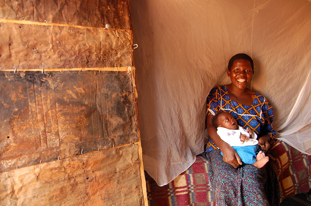 Baby with mosquito net in Uganda