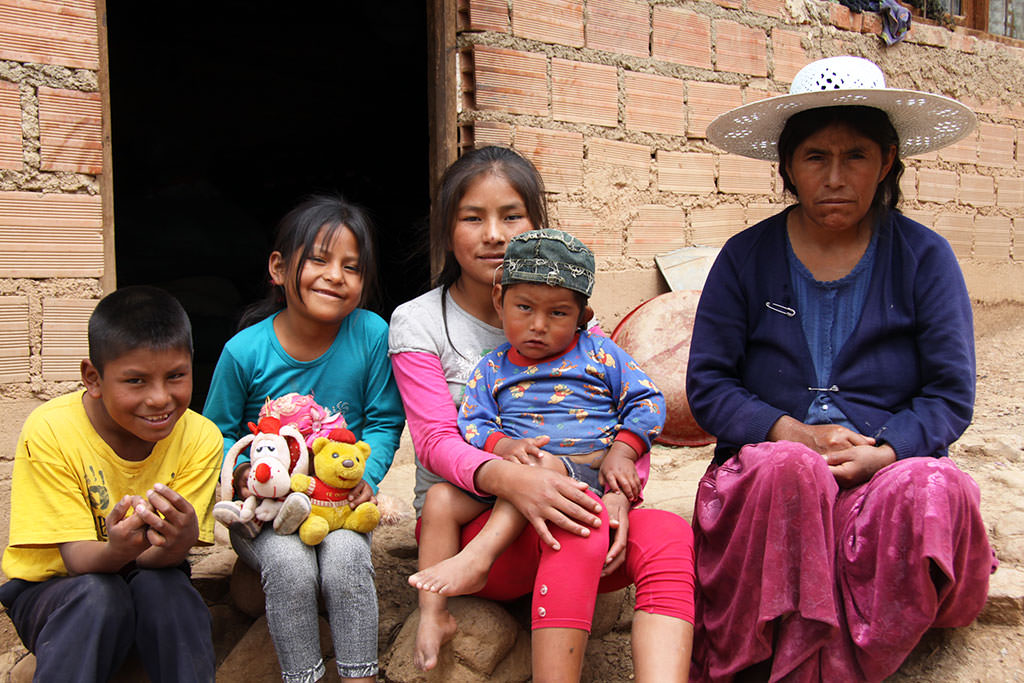 Family outside their home in Bolivia