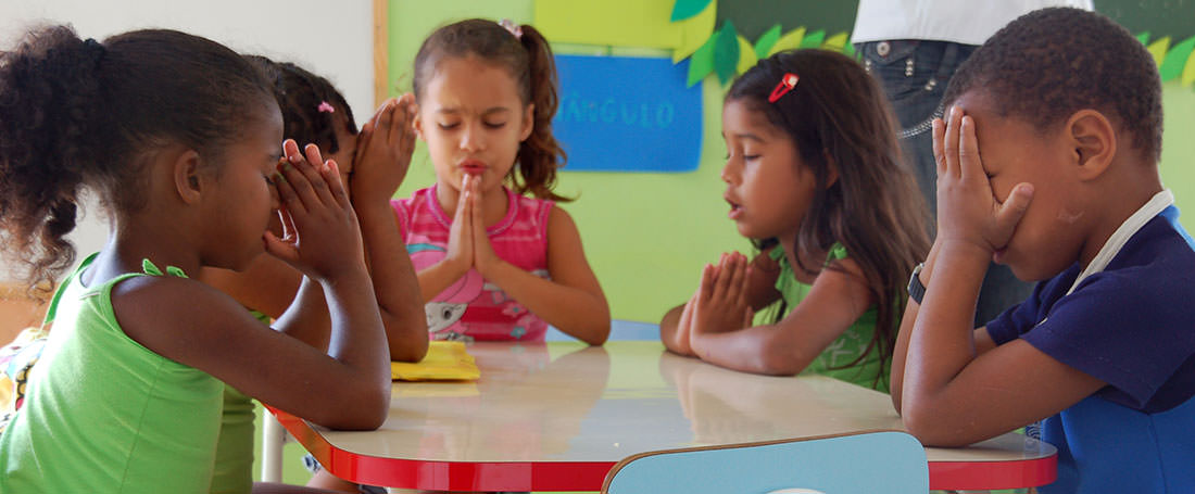 Group of Brazilian children praying