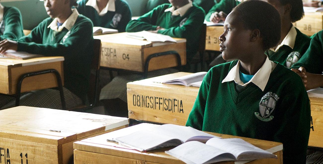 Girl sitting at desk in Kenya