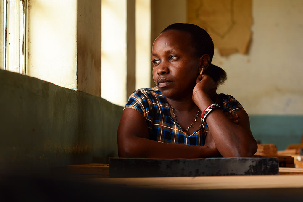 Jennifer sits in a Kenyan classroom