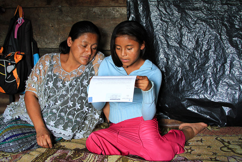 Mother and daughter reading sponsor letters