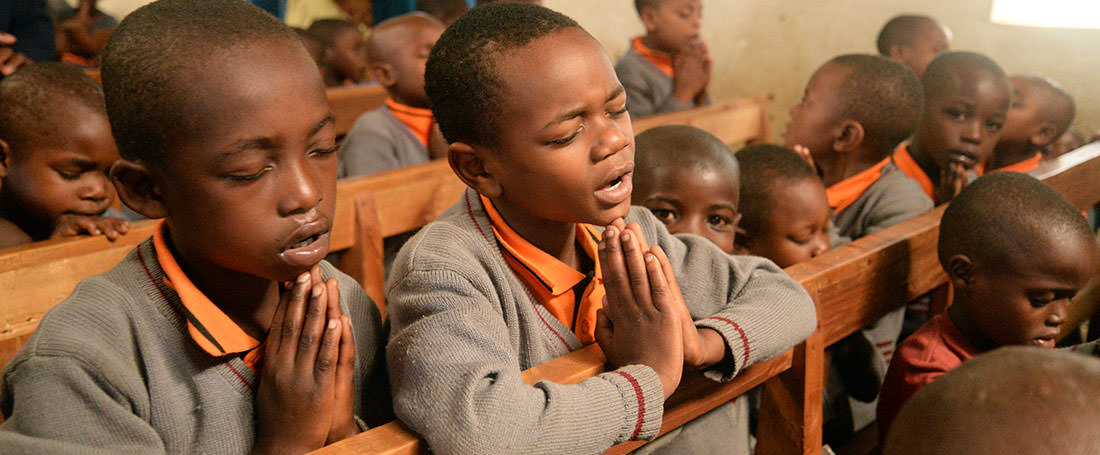 Ugandan boys praying