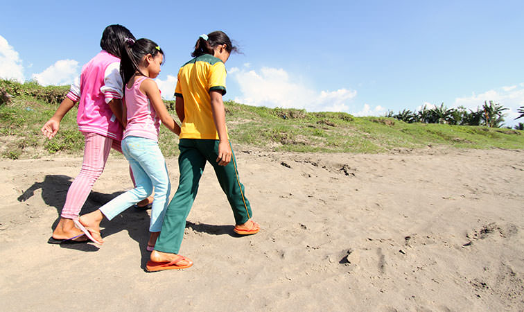 Children walking to a Compassion project