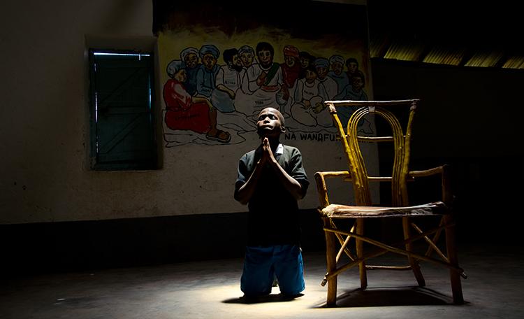 Boy praying at Lent