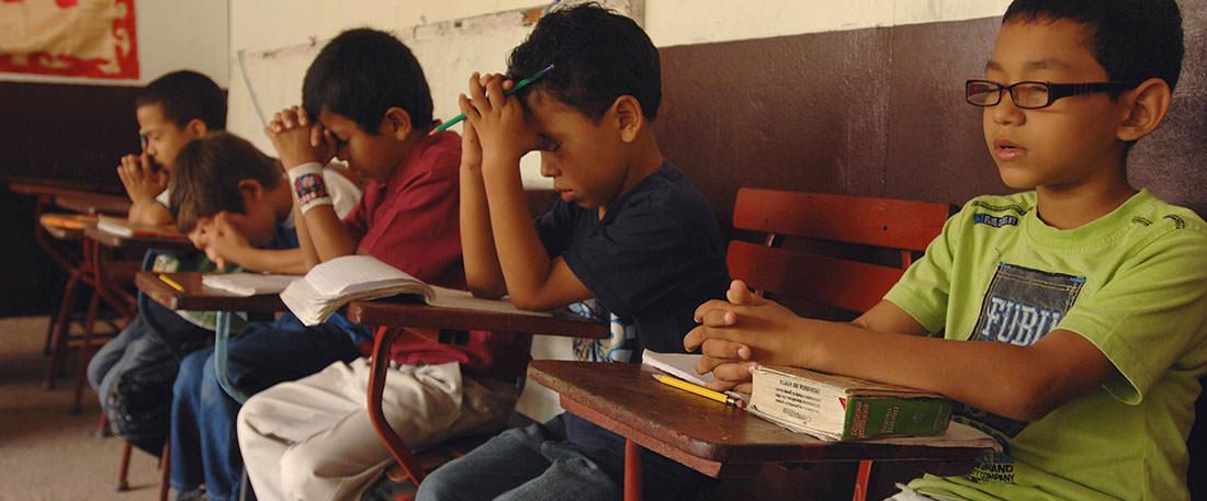Boys praying in Nicaragua