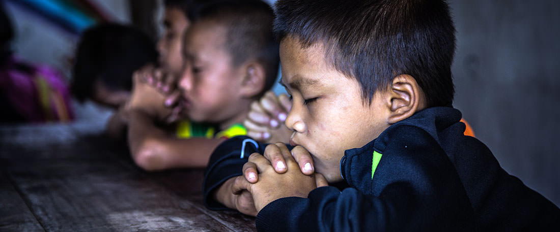 Children praying in Thailand