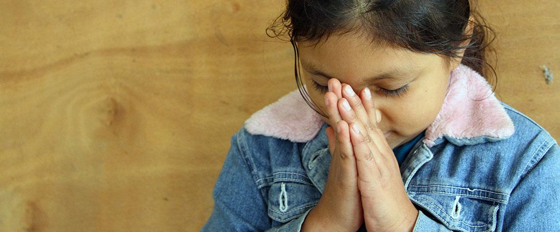 Girl from Guatemala praying