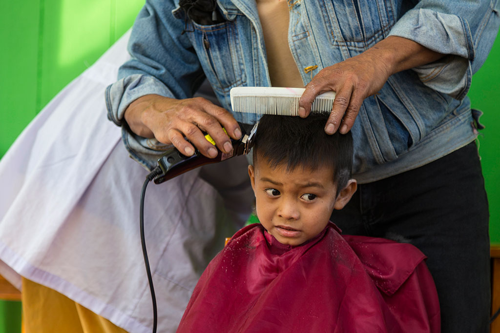 Haircut at a Compassion project