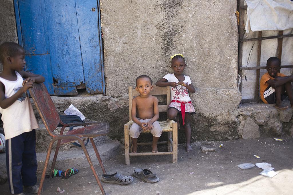 Haitian boys sitting on chair