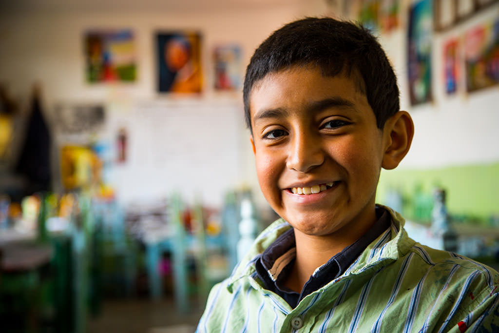 Child artist Hector from Mexico smiling