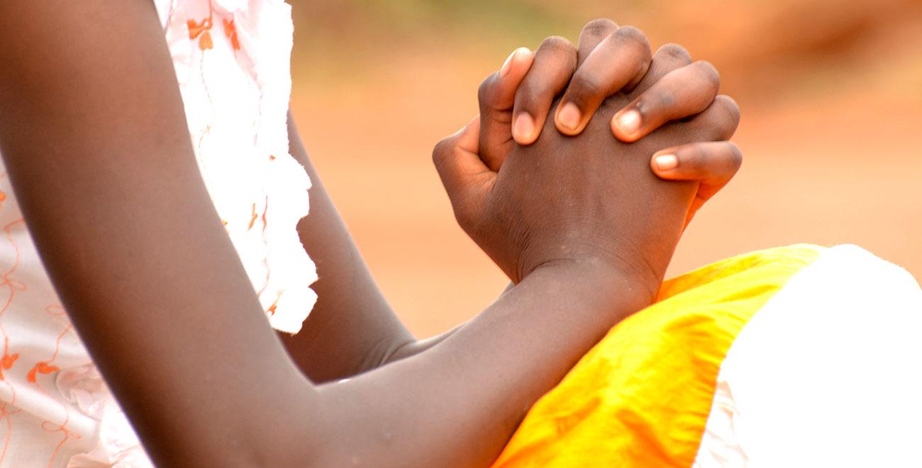 Sponsored child Koki praying
