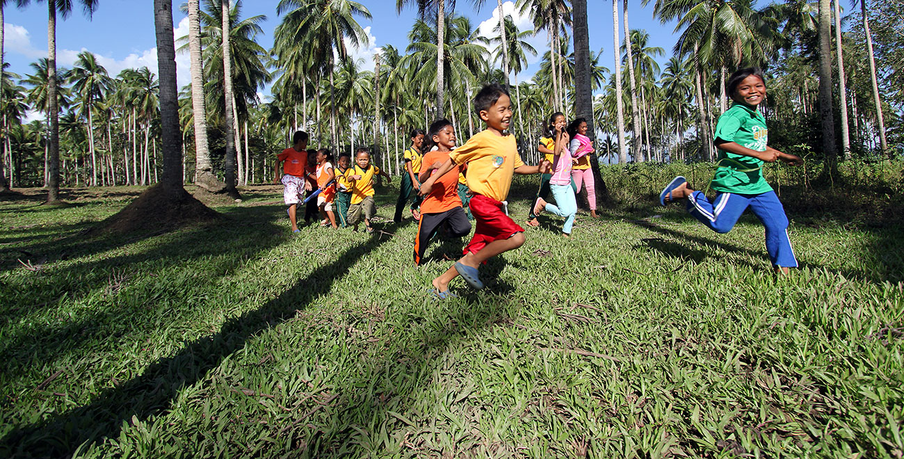 Children running in the Philippines