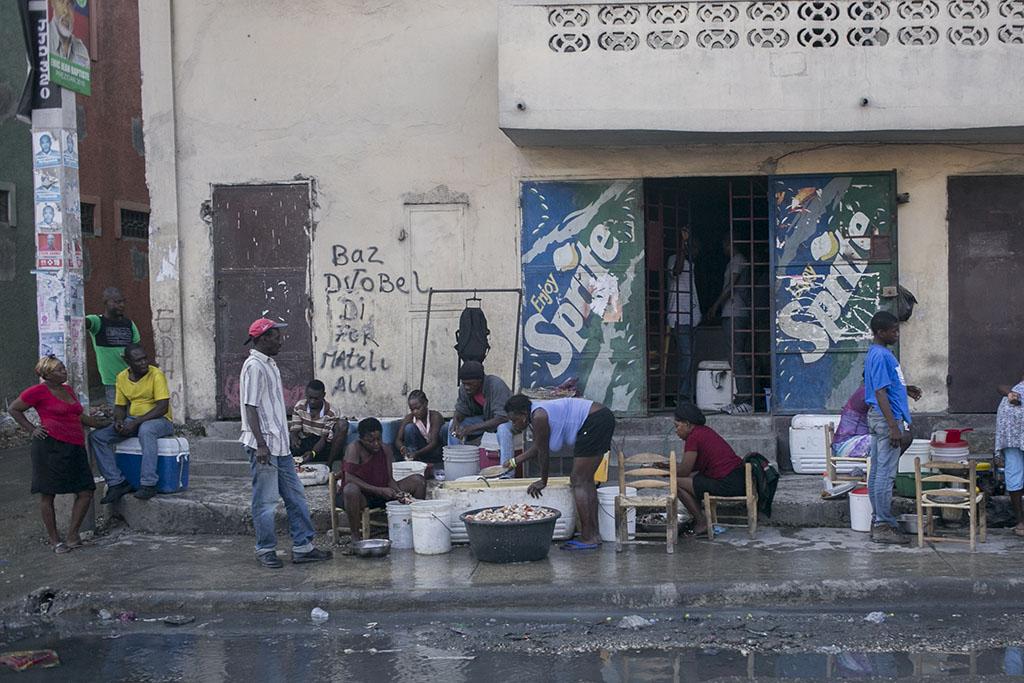 Preparing food on the streets of Haiti.