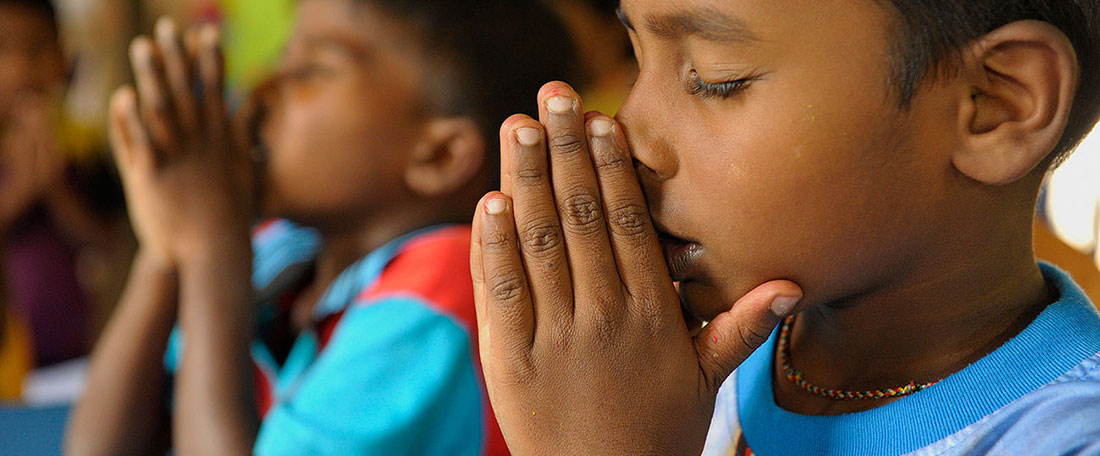 Sri Lankan boy praying