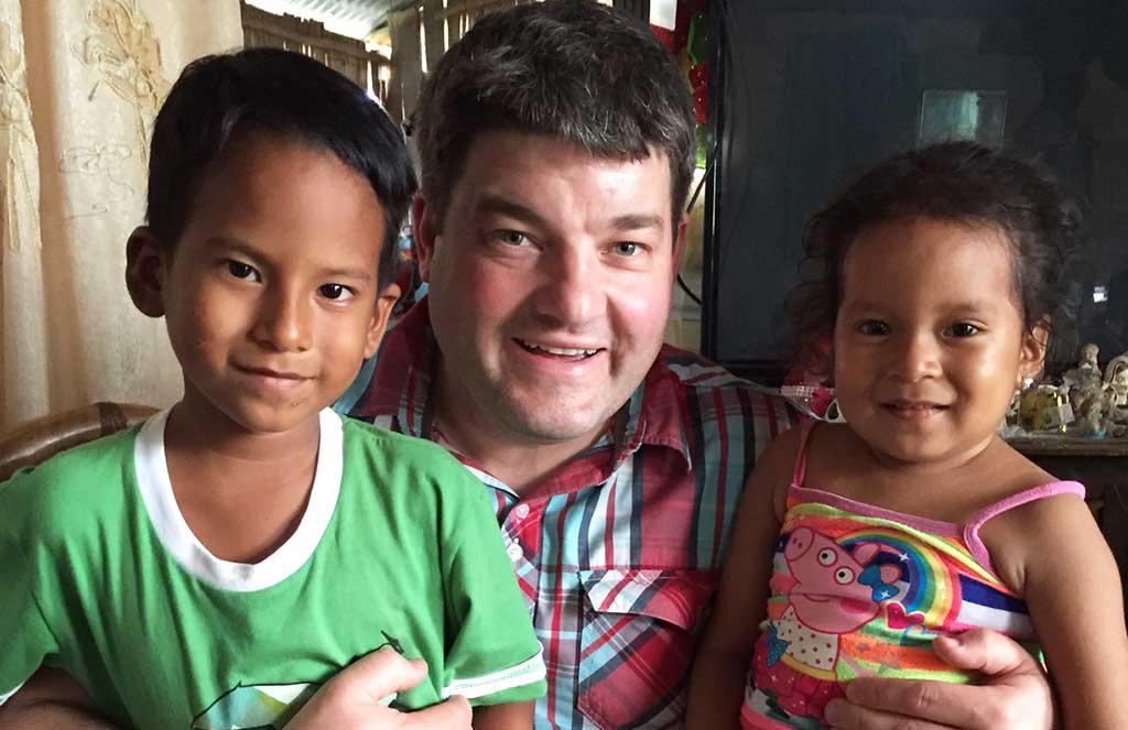 Sponsored child Benjamin with Compassion UK CEO