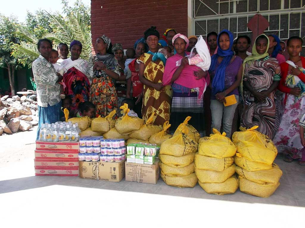 Compassion mothers with food packages in Ethiopia