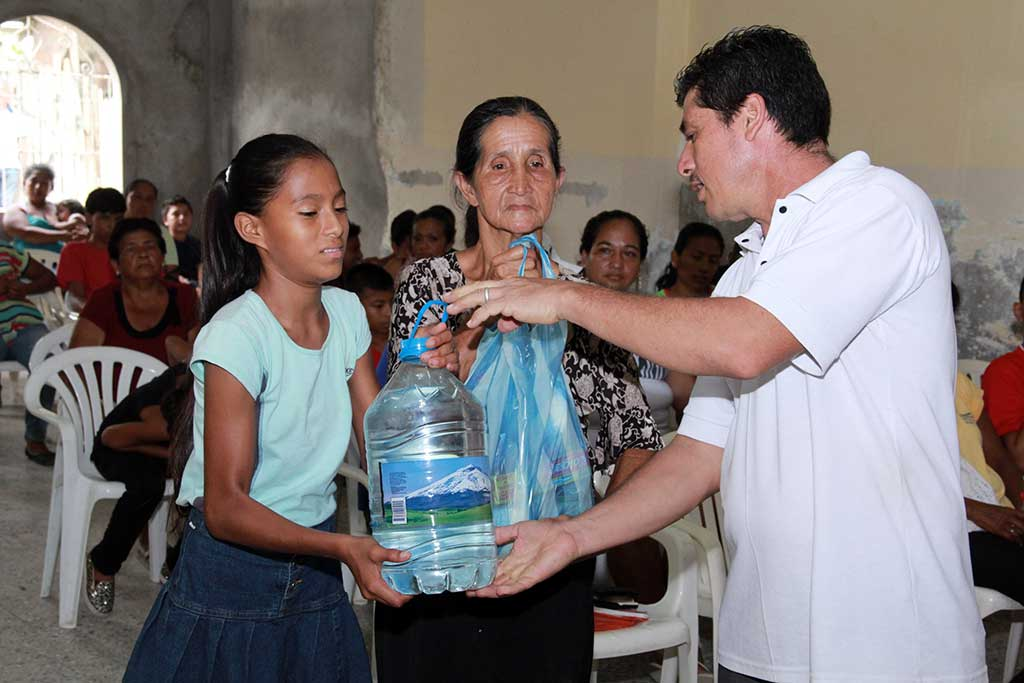 Giving out clean water in Ecuador