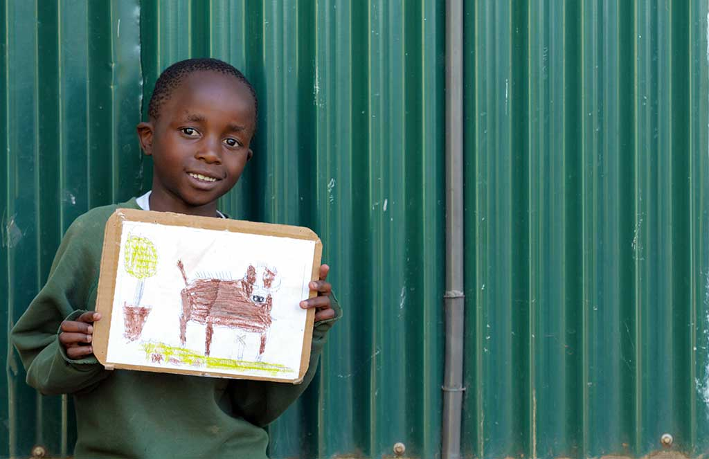 Sponsored child Luis holding his picture
