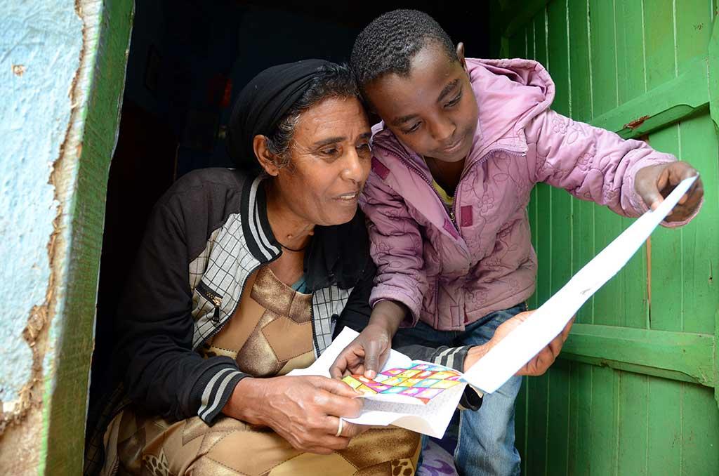 Nathnael from Ethiopia reading sponsor letters