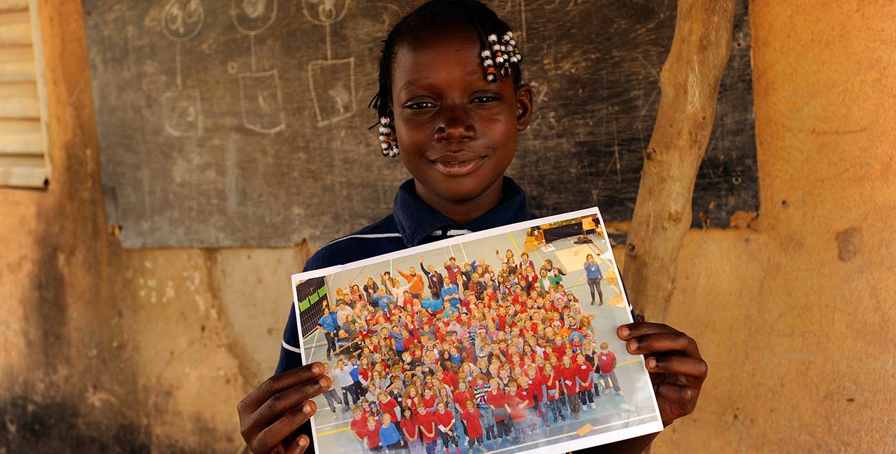 Holding a photo from her sponsor