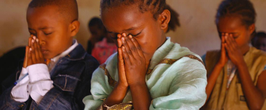 Children praying in Ethiopia