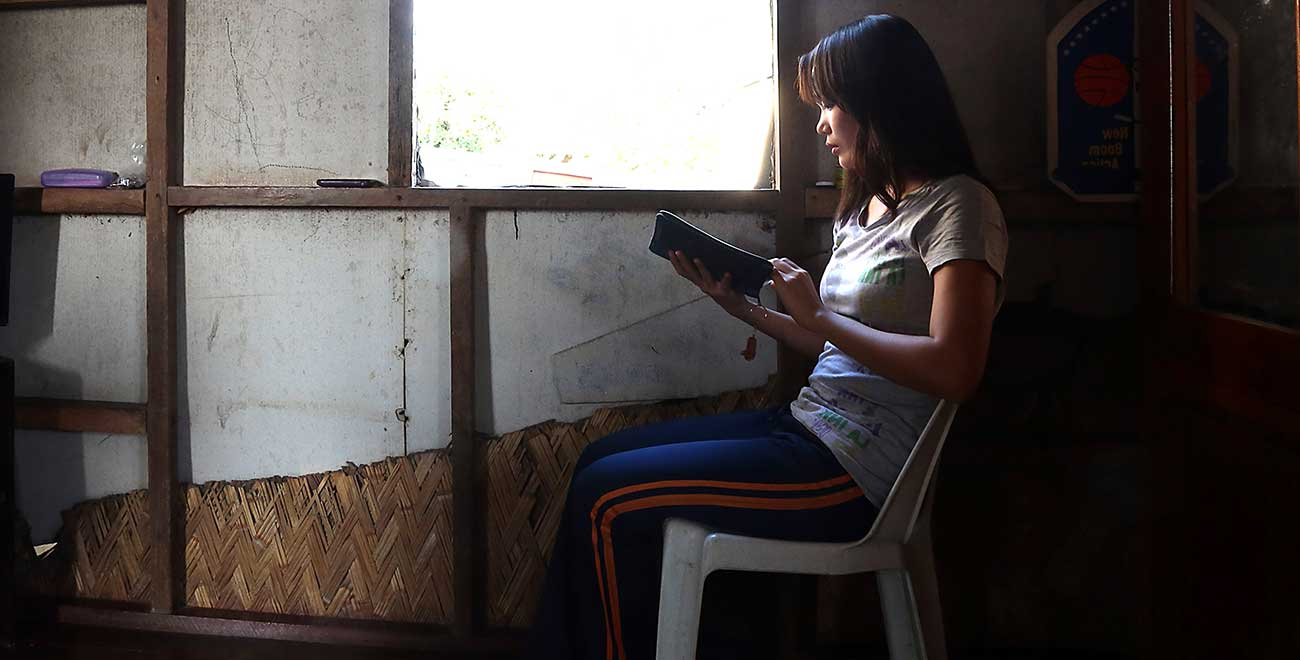 Reading Bible by window