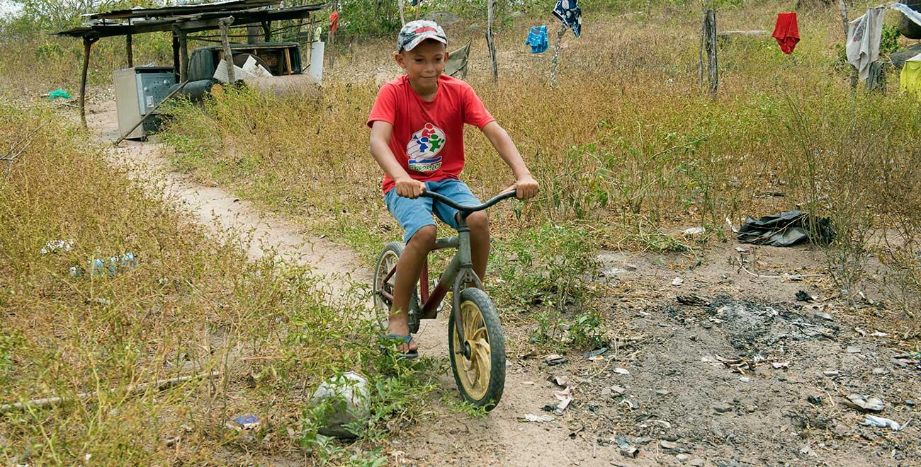 Sponsored child Samson riding his bike in Brazil