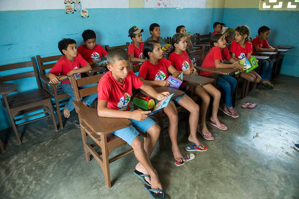 Tiago studying at his Compassion project.