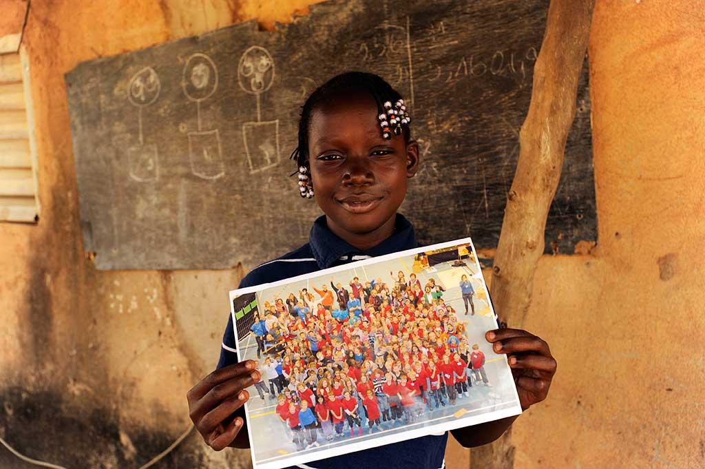 Sponsored girl in Burkina Faso holding photo