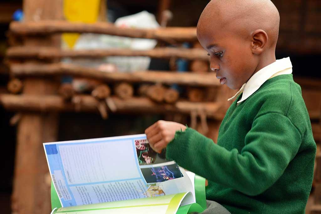 Watson from Kenya reading sponsor letters