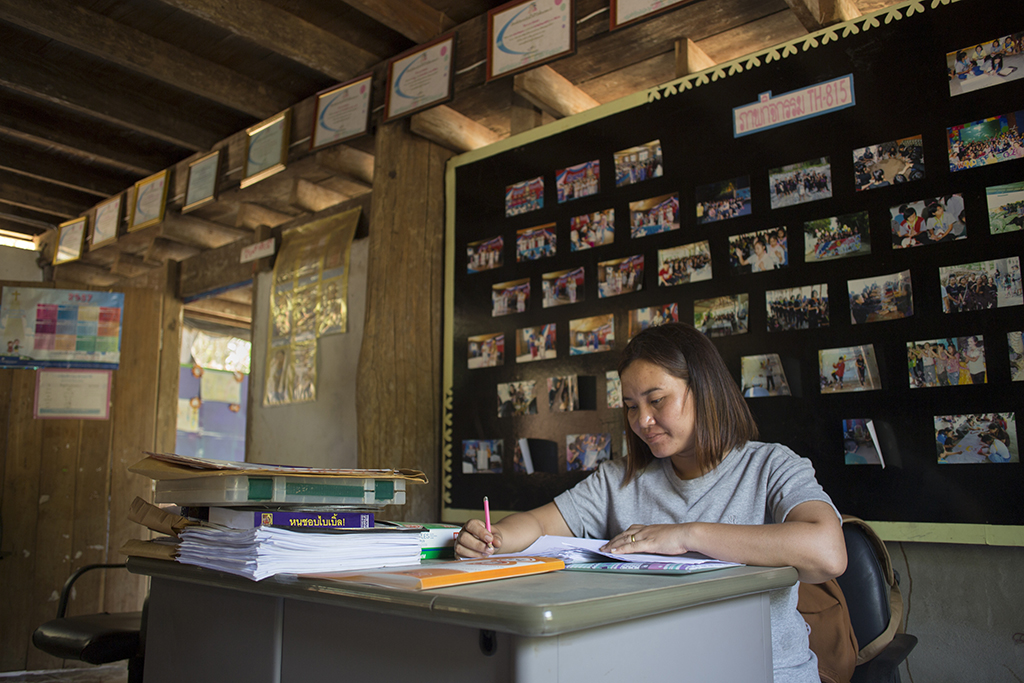 Gai works at a desk