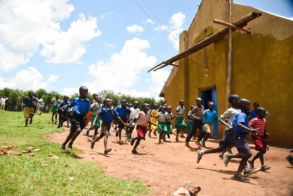Children running in Rwanda