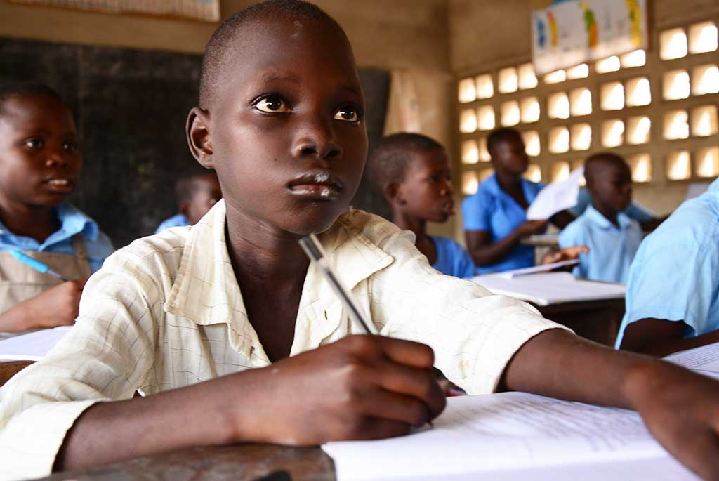 Sponsored child Paul learning at school