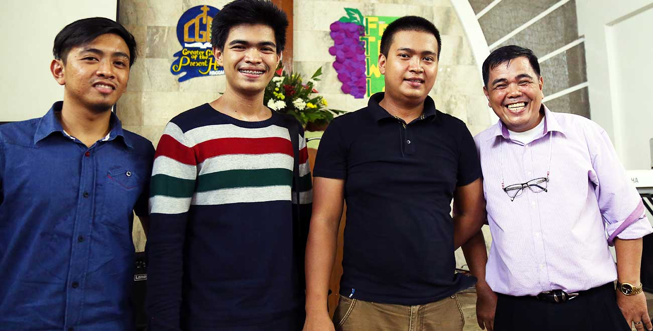 Philippines Pastor with his sons