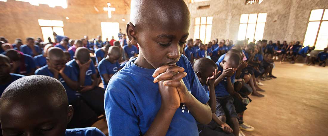 Boy praying in Rwanda