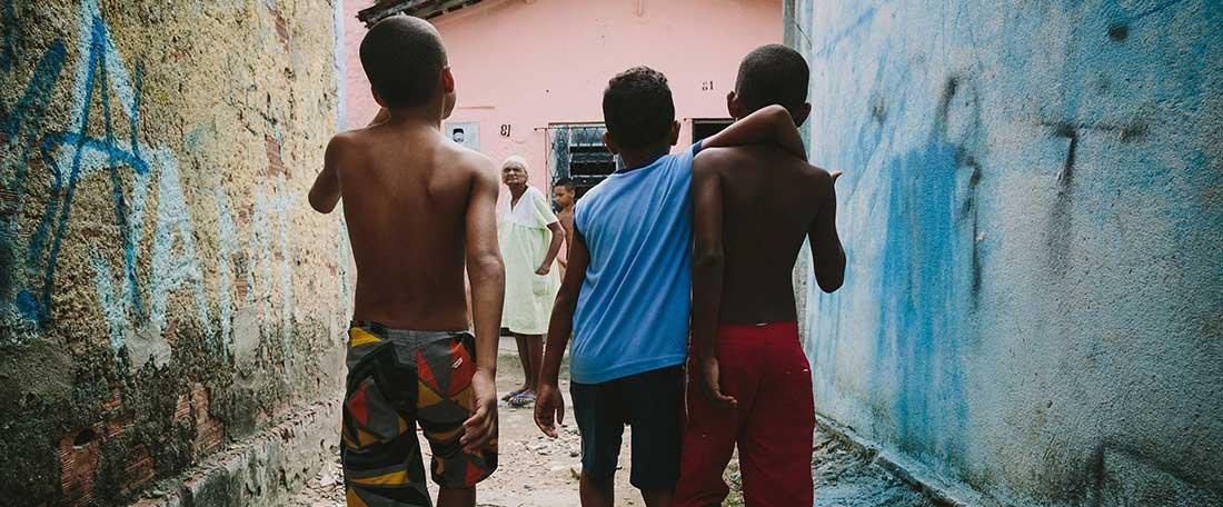 Boys walking down street in Brazil