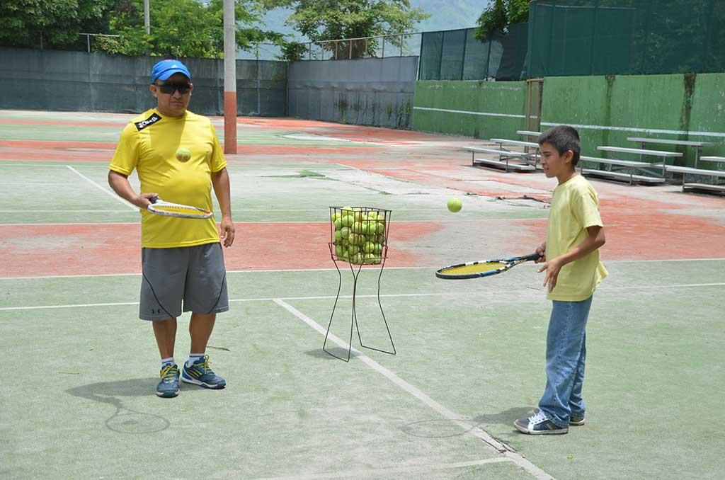 Kevin playing tennis