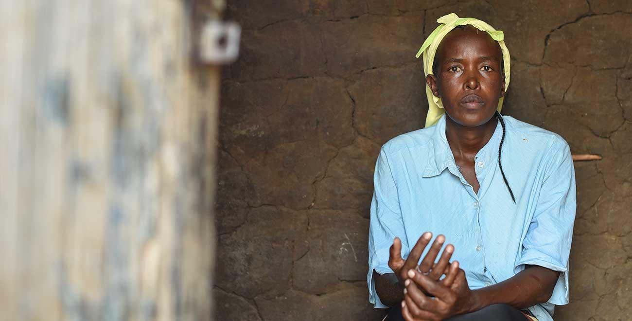Kenyan woman through doorway