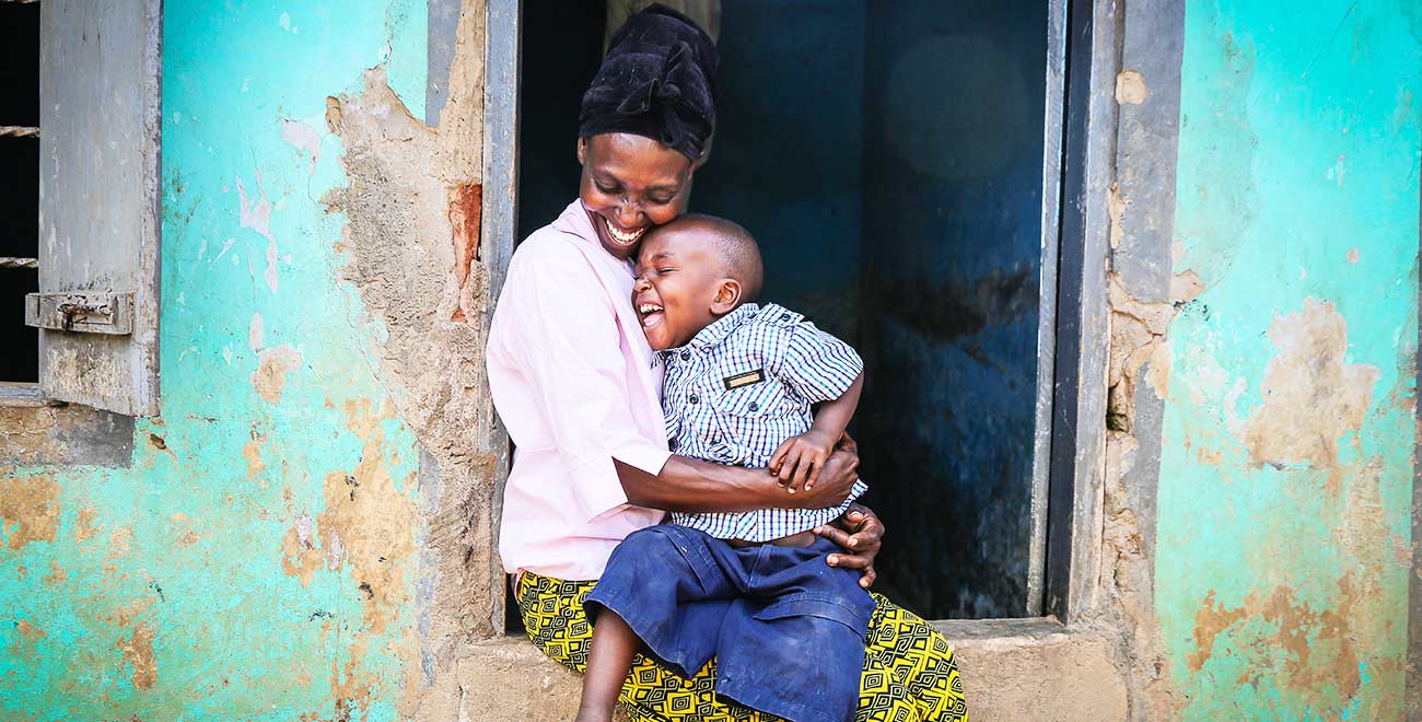 Smiling mother and child in Uganda