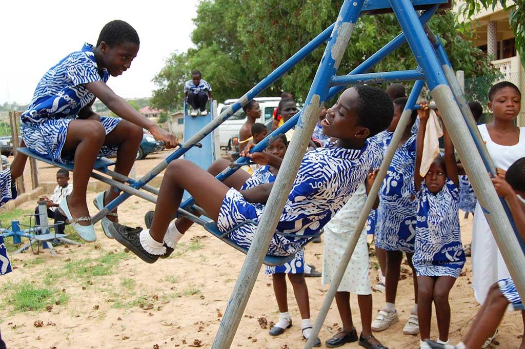 Playing on swings in Ghana