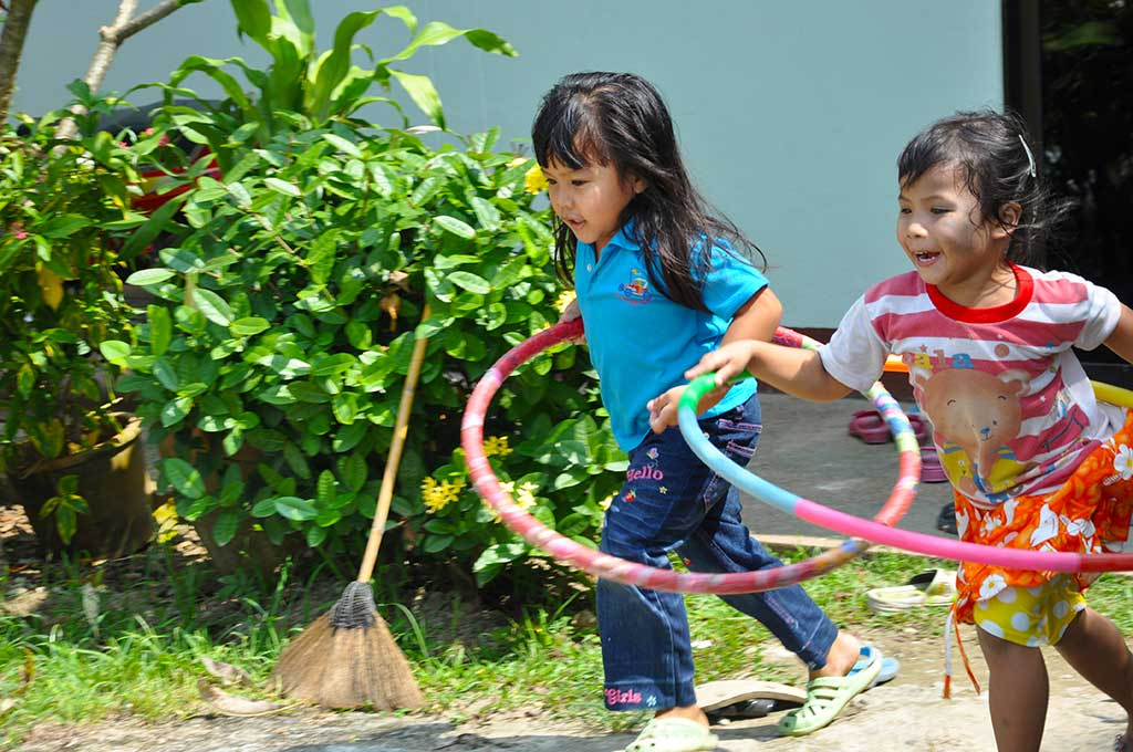 Thai girls playing with hoops