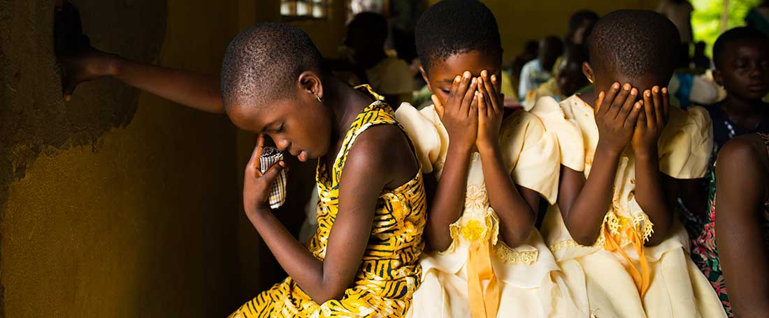 Girls praying in Ghana