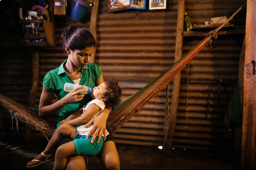 Cindy feeding her baby