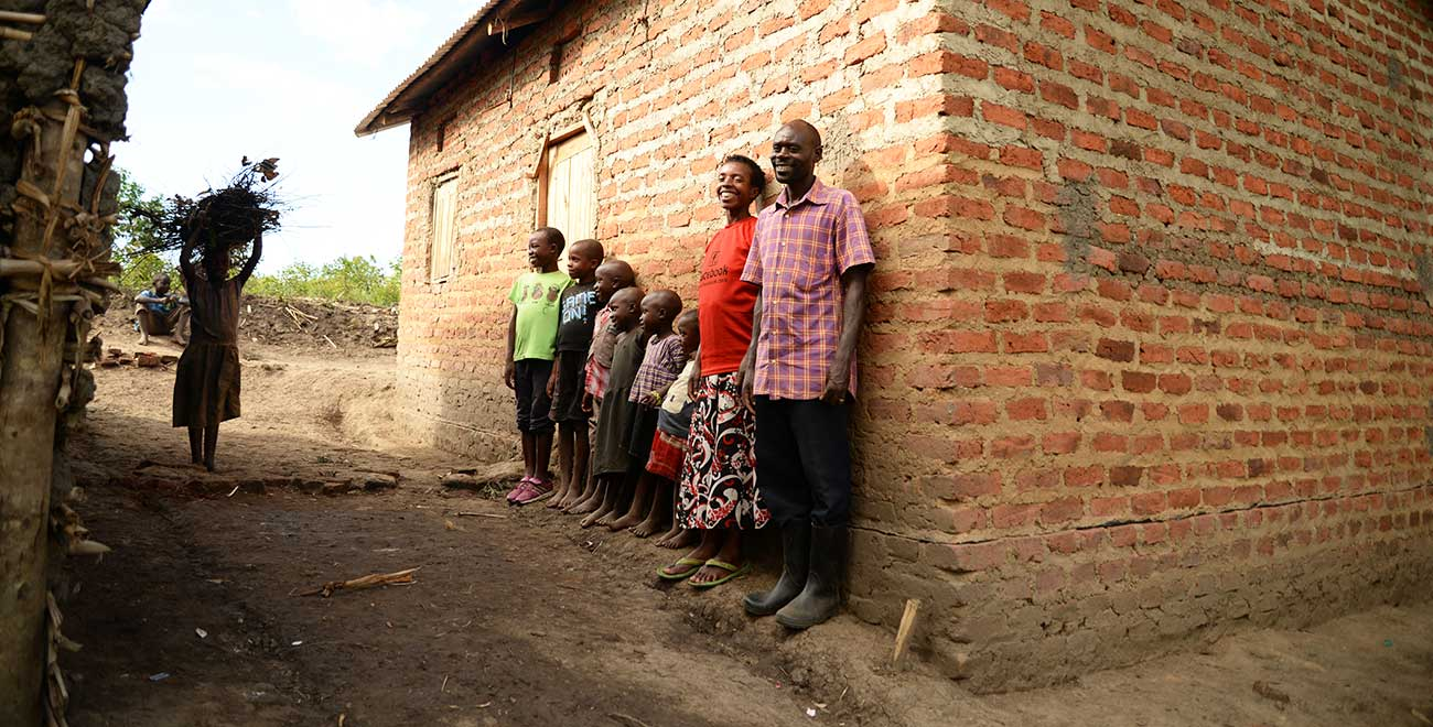 Ugandan family outside their home