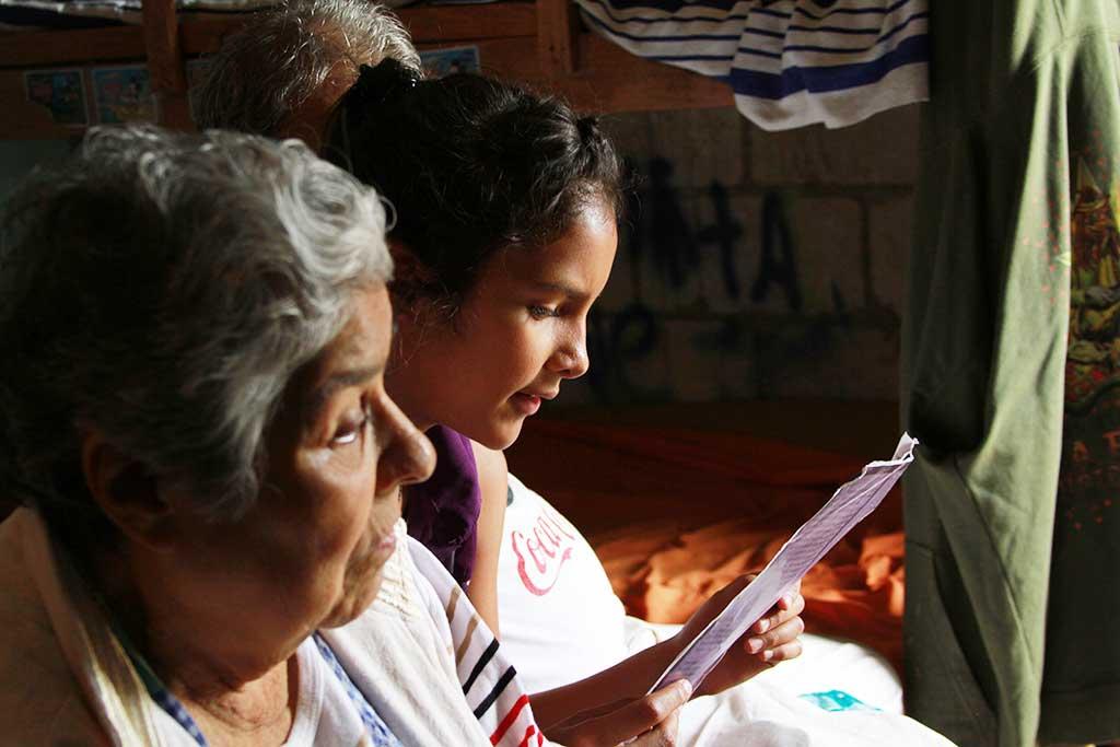 Girl reading sponsor letters