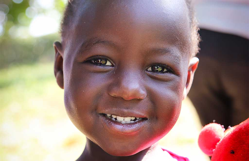 Smiling girl in Uganda