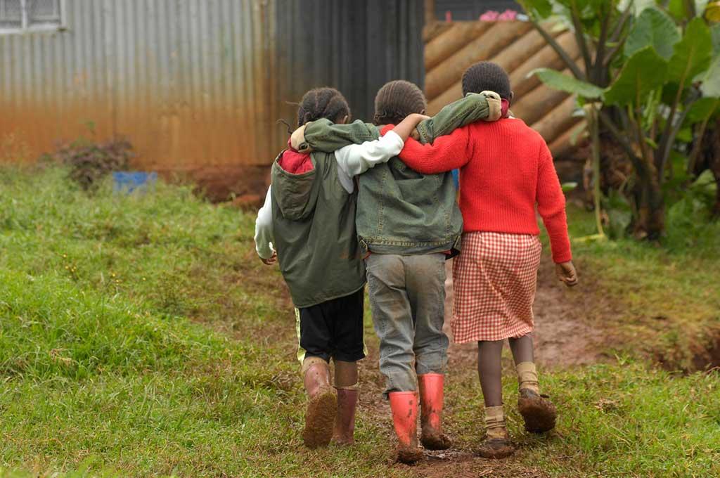 Friends walking arm in arm